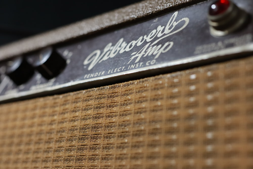 brown and black guitar amplifier