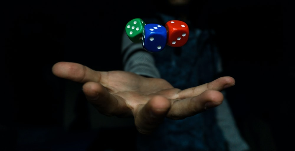 person throwing three dices