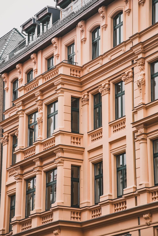 selective focus photography of beige concrete building
