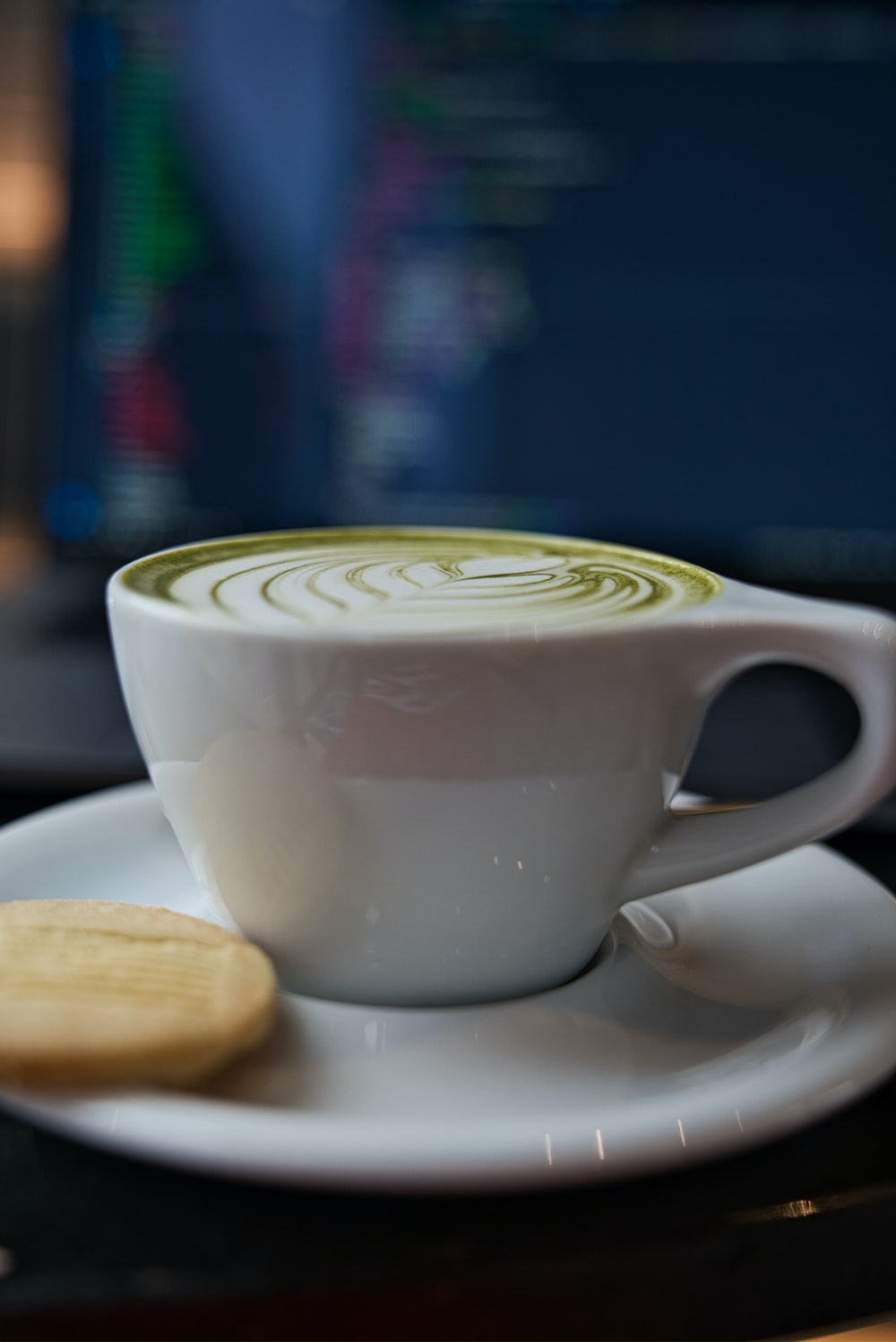 white ceramic teacup with saucer close-up photography