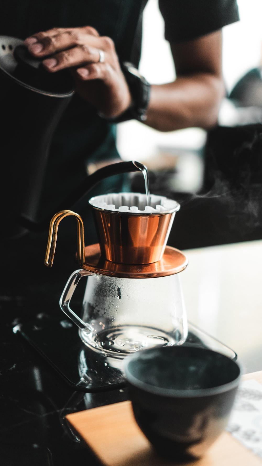 person near coffeemaker