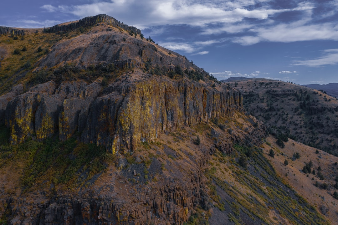I spotted this random formation long ago because of it's boxy shape and the colorful mosses on the cliff face. I recently made it back out to this part of Central Oregon's high desert and took a few photos with my drone. That is some wild geology.