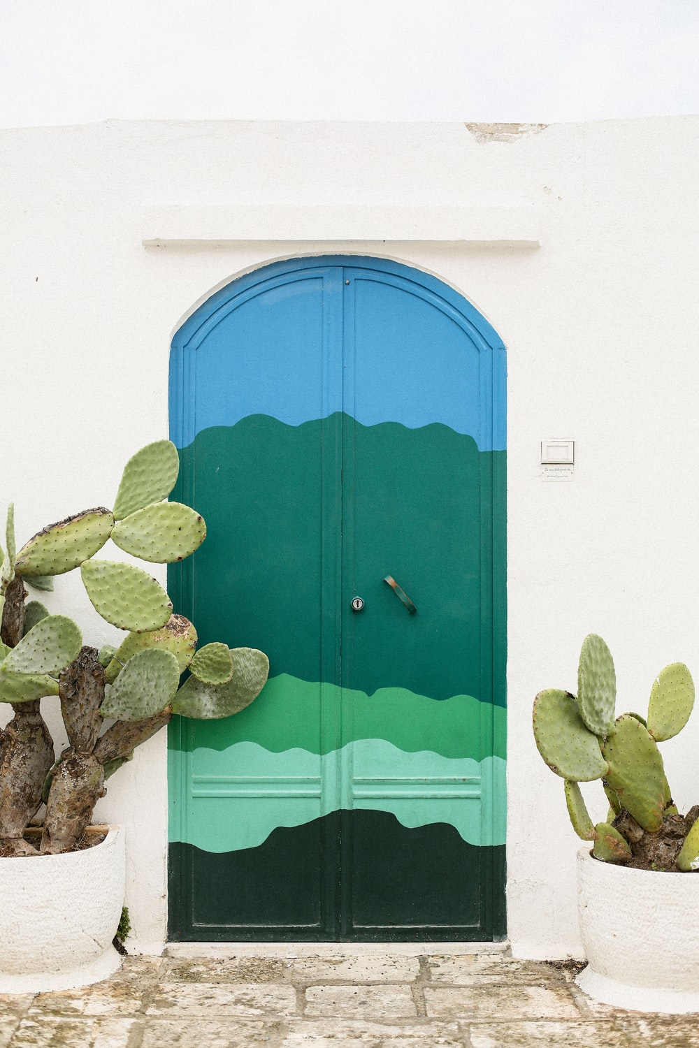 green and blue wooden door close-up photography