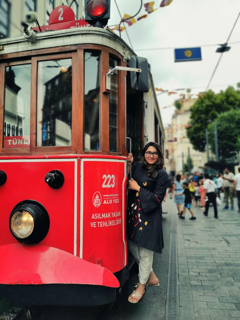 woman beside train
