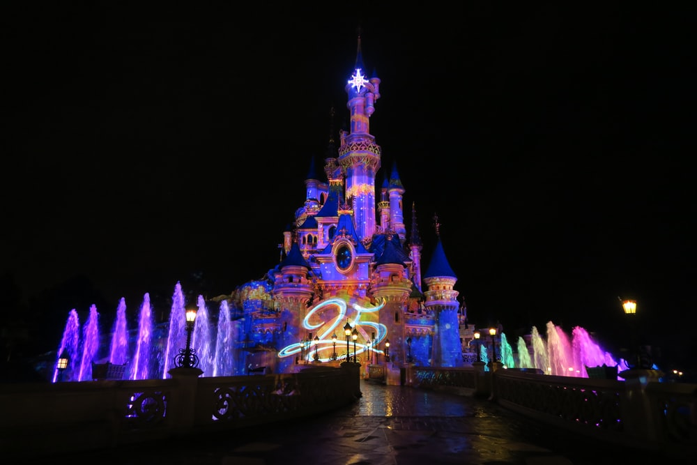 view of lighted Disneyland castle at night
