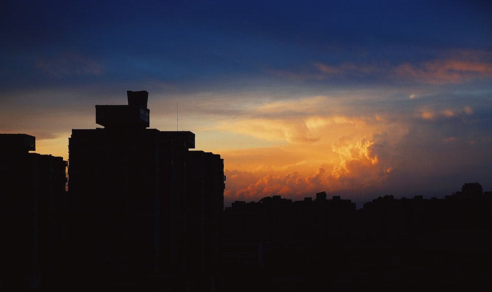 silhouette of building during golden hour