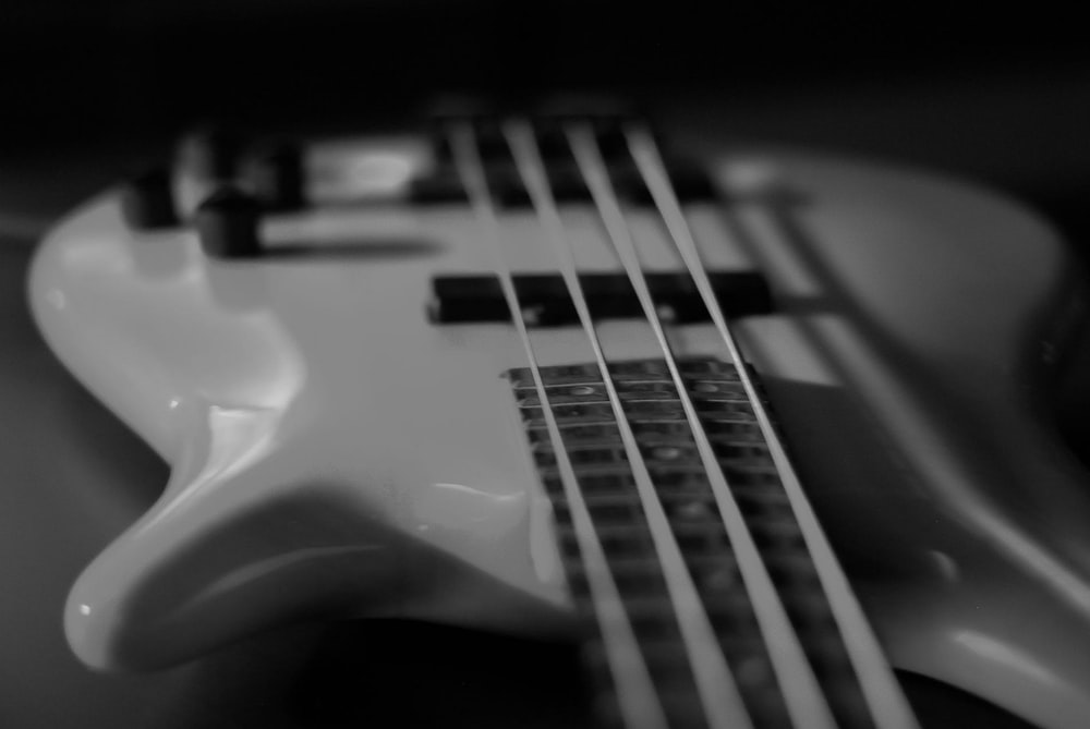 white electric bass guitar
