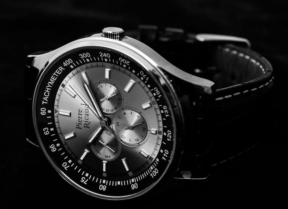 round silver chronograph watch