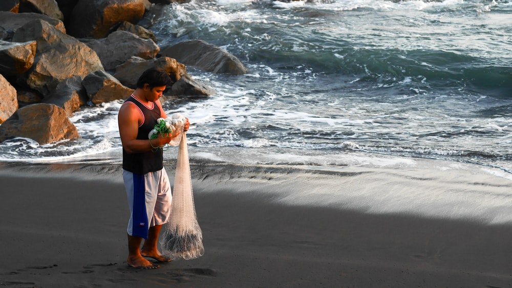 man holding fish net