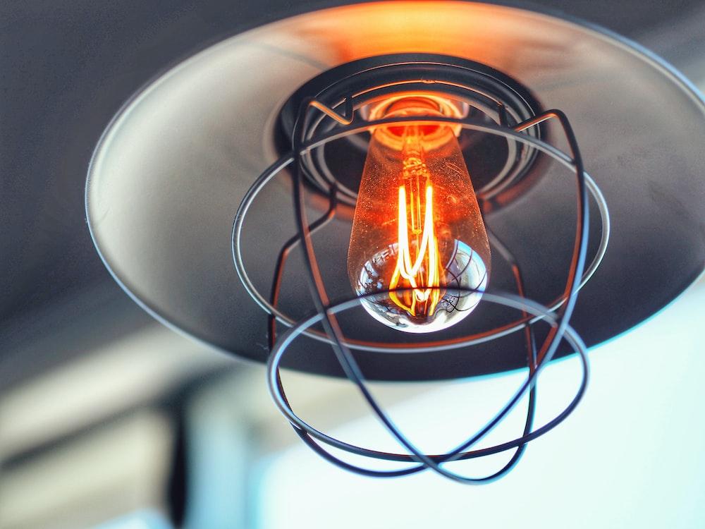 selective focus photography of yellow light bulb