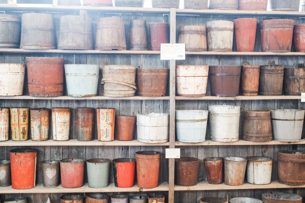 assorted-color pots on r