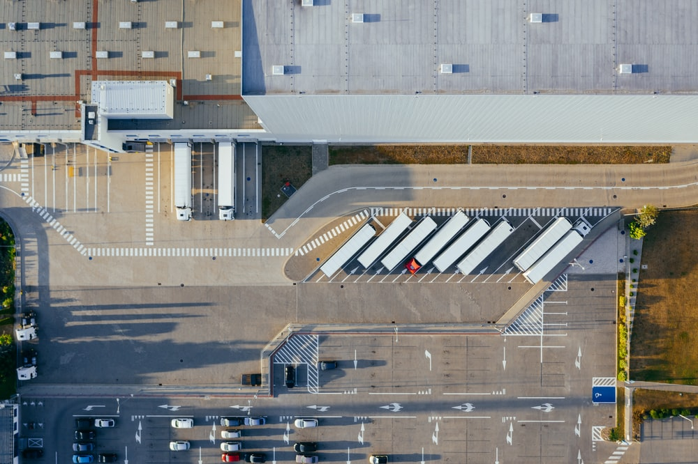 aerial view of vehicles in parking area