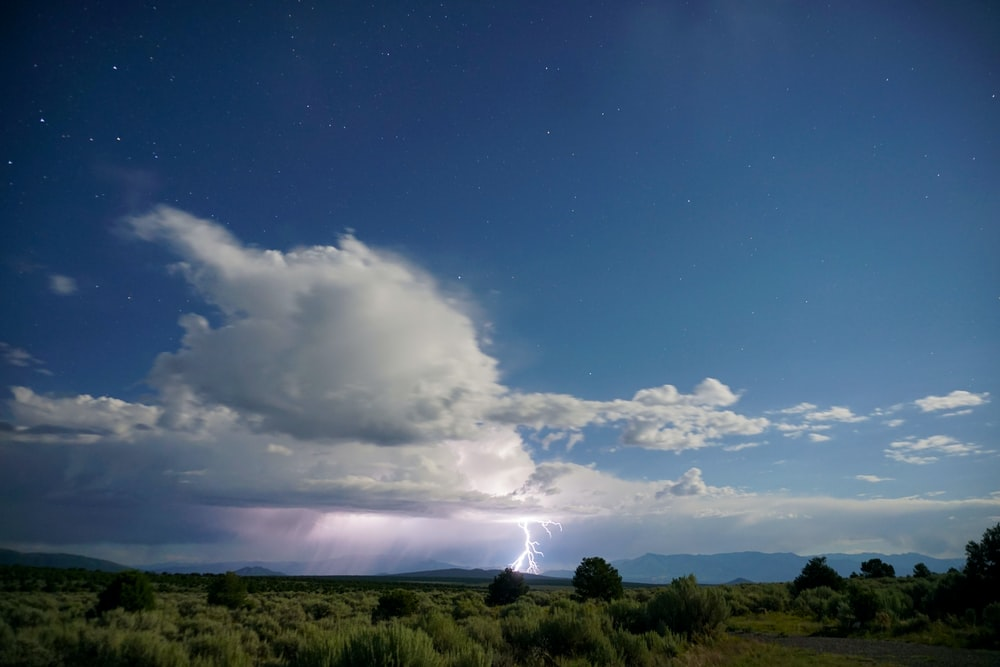 photo of white clouds and thunderstorm