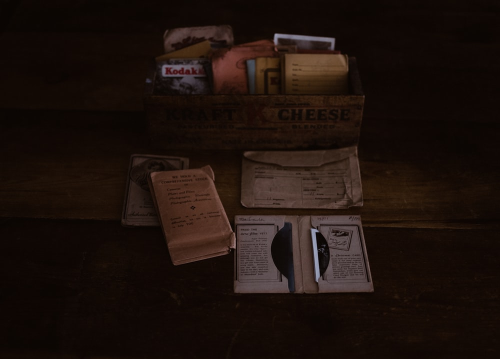 brown wooden crate with books