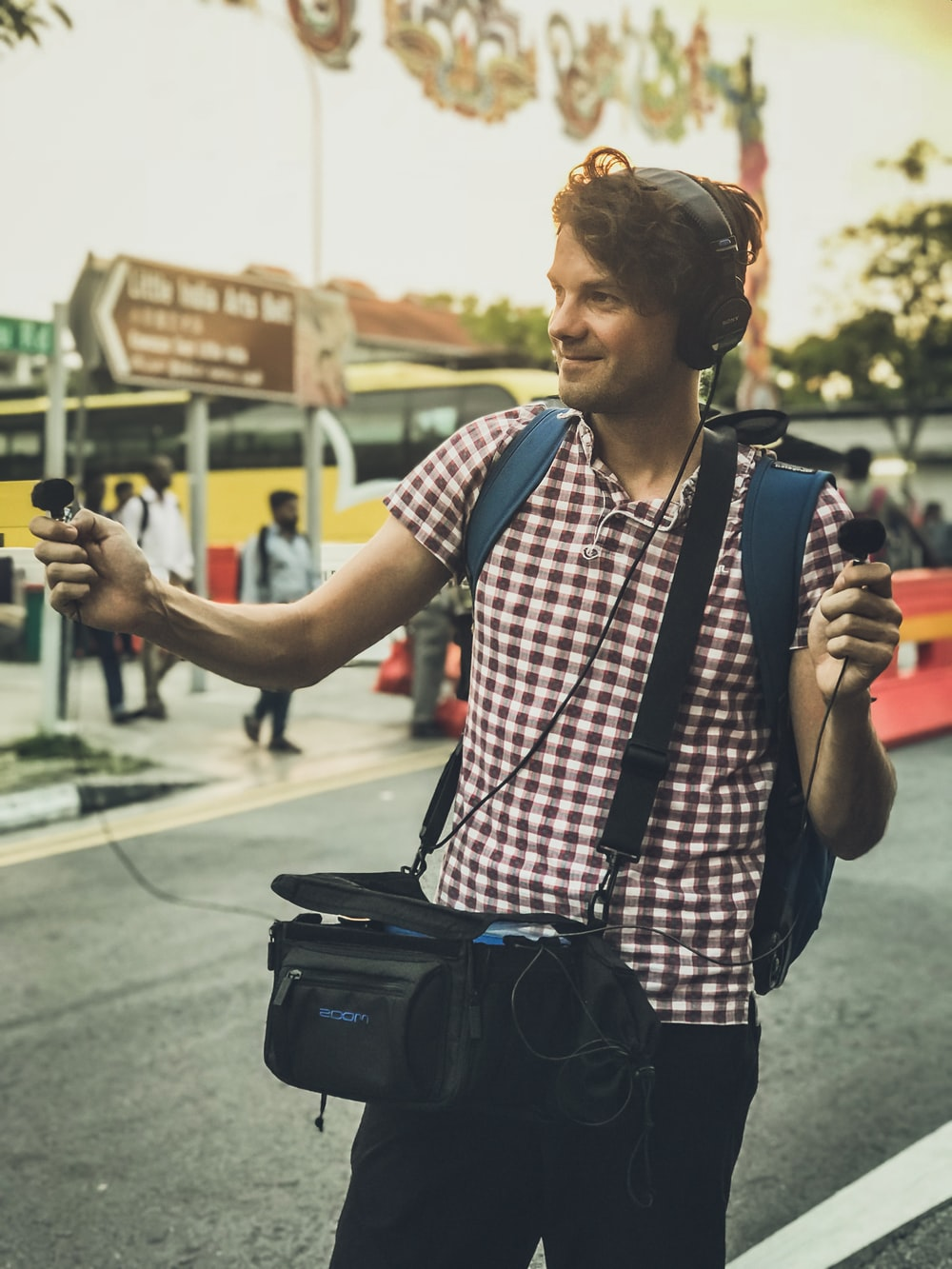 man carrying audio device and microphone