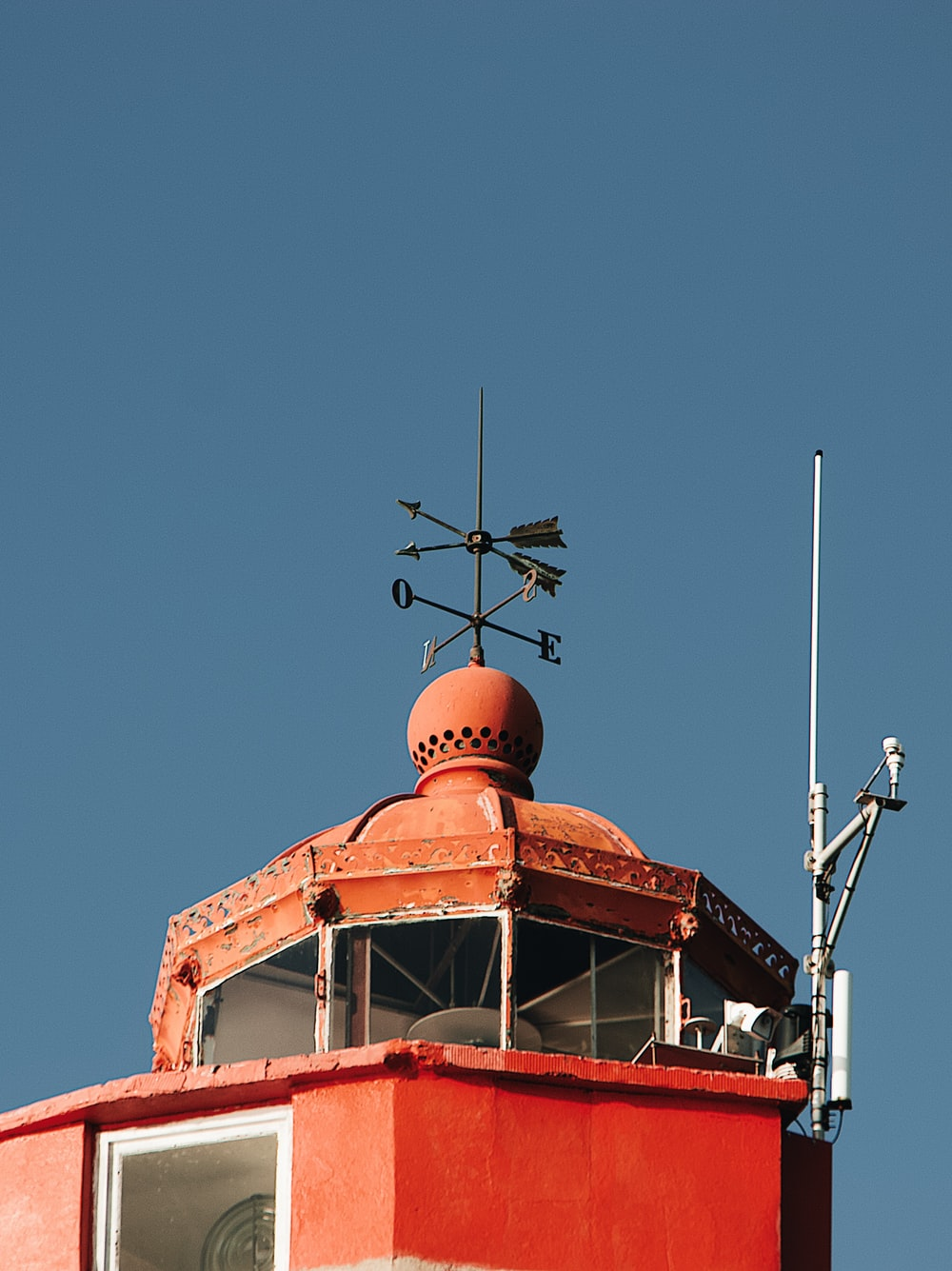 red building with brown arrows weathervane