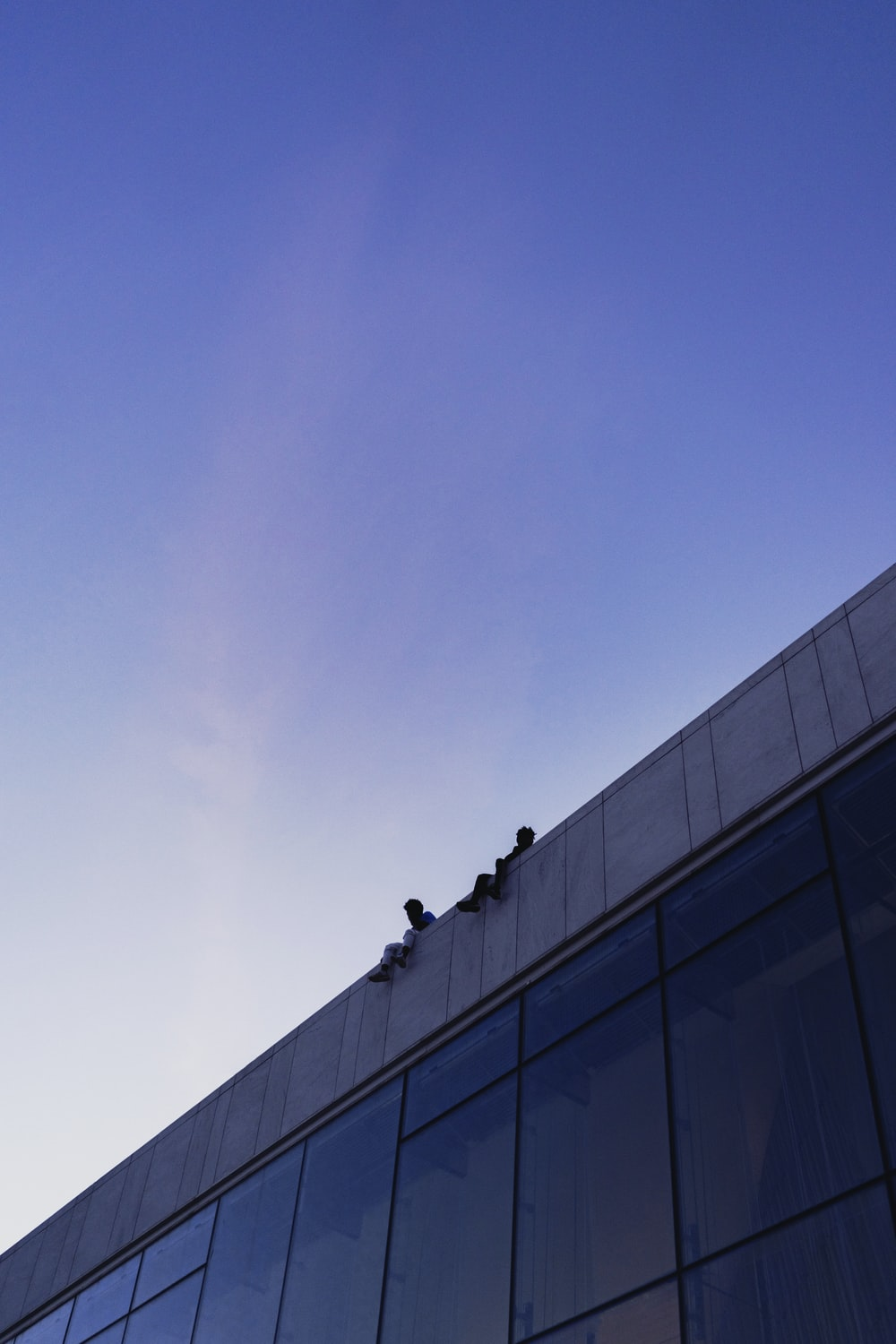 architectural photography of blue and gray building