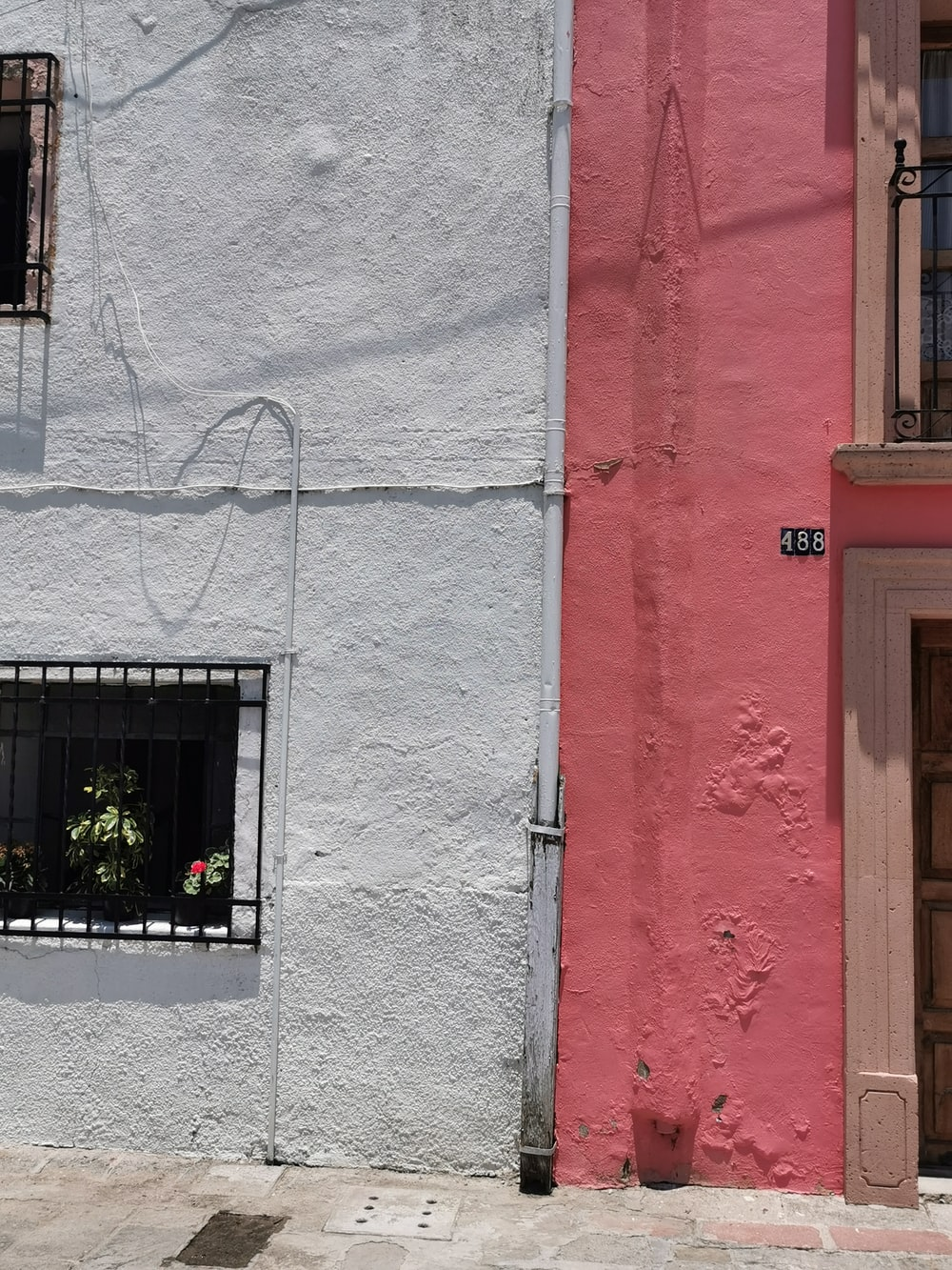 white and red building