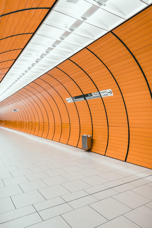 white and orange tiled hallway