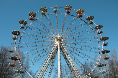 white and brown ferris wheel photo lithuania teams background
