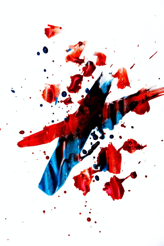 black. blue, and red ink splatter