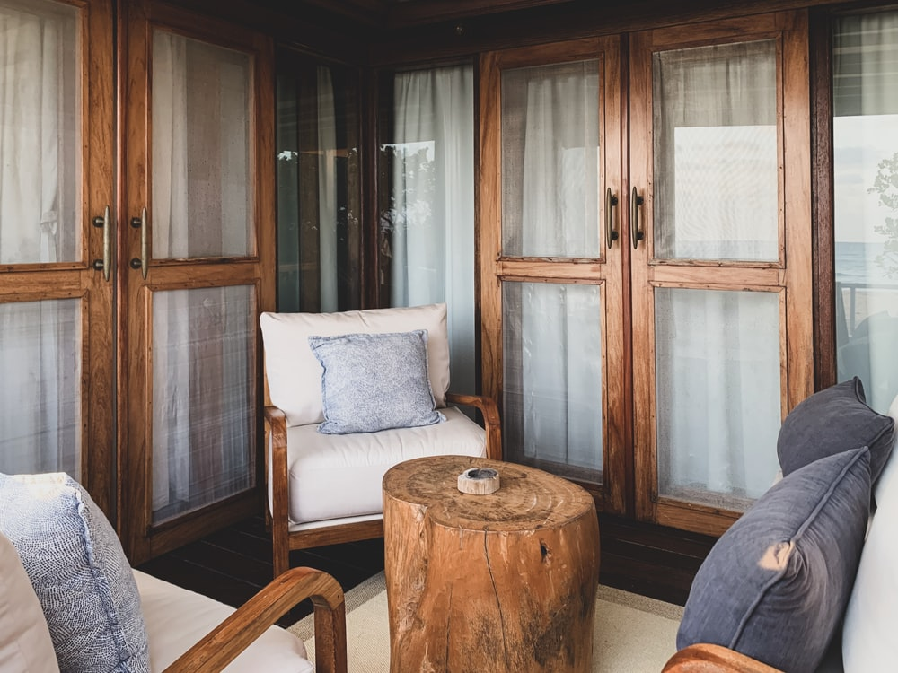 wood stump coffee table between wooden armchairs