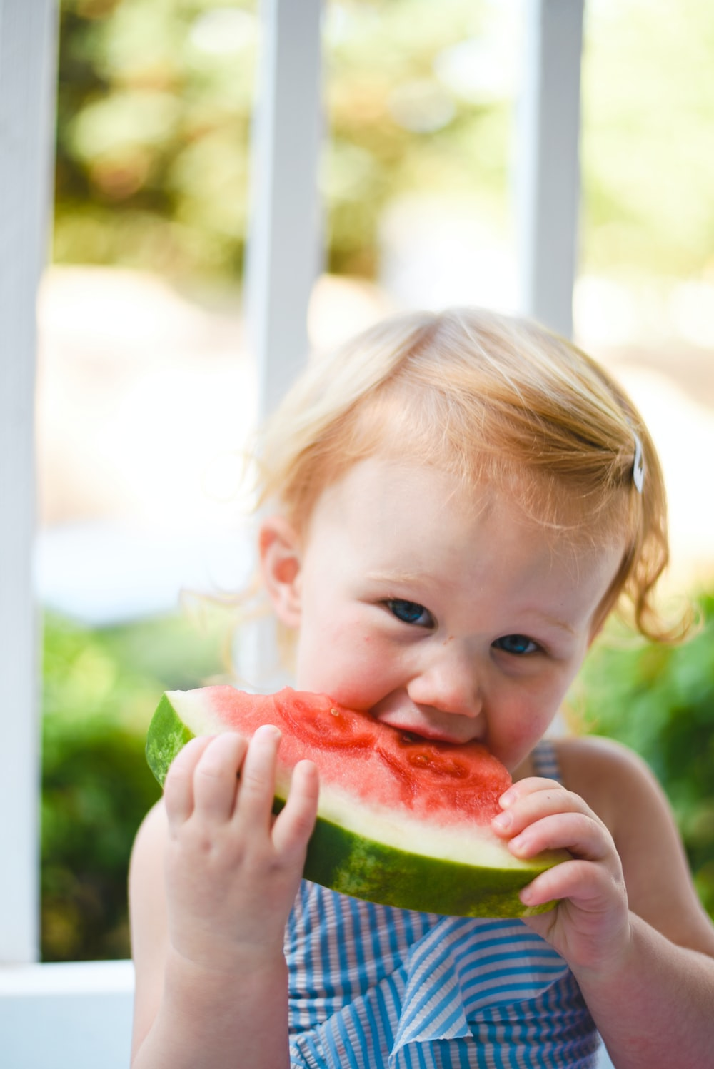 girl eating watermelon close-up photography