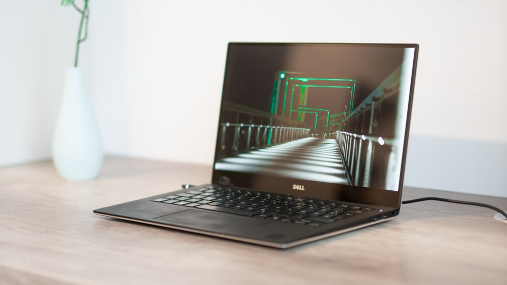 turned-on black Dell laptop computer
