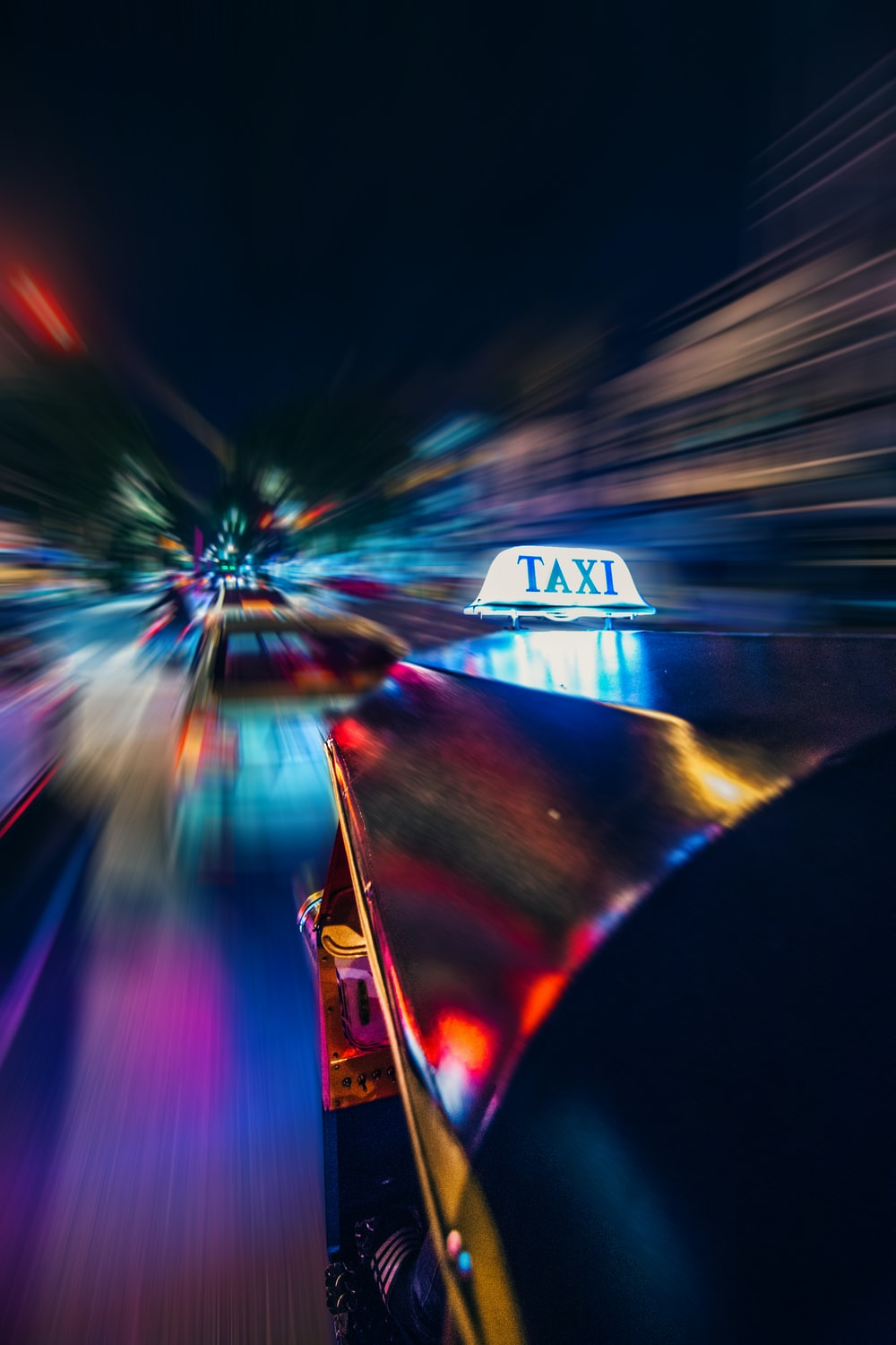 yellow taxi time lapse photography