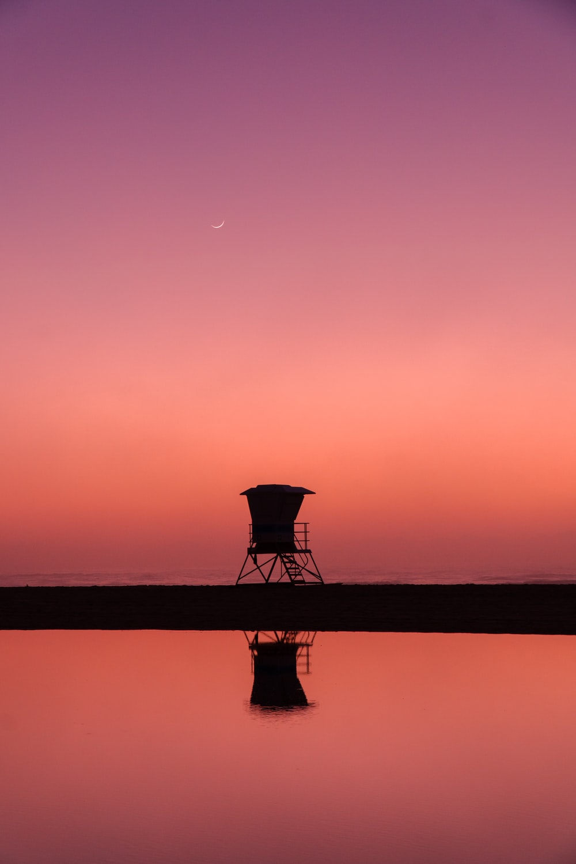 silhouette photo of lifeguard house