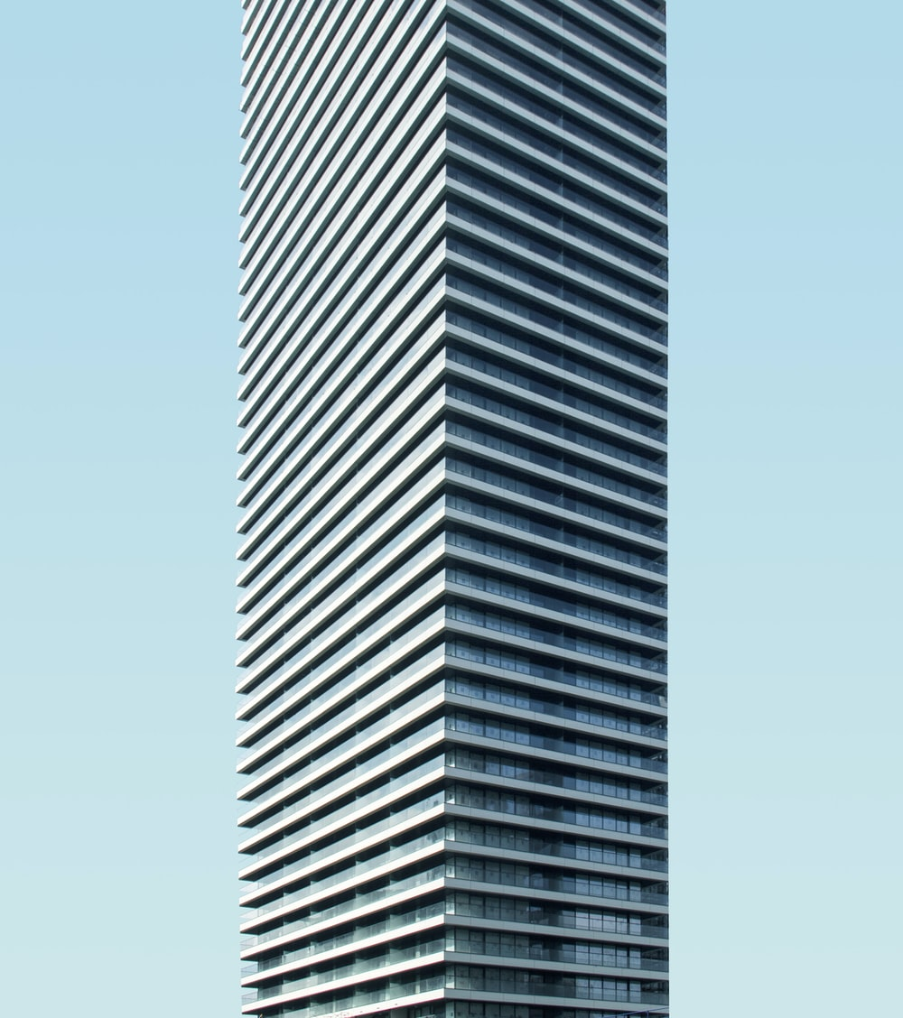 low angle photo of curtain glass wall building