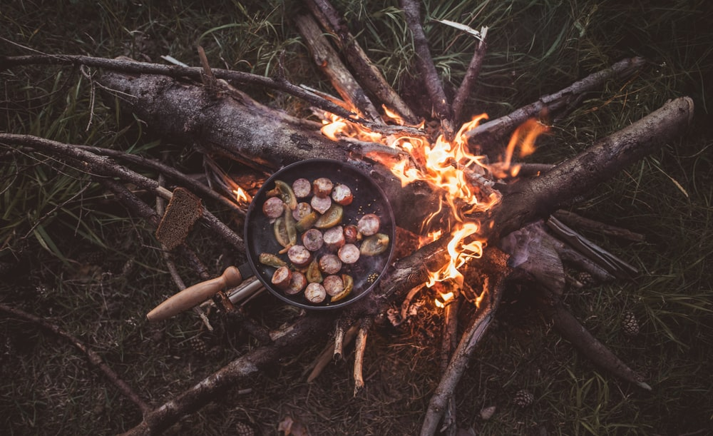 food in cooking pot with fire