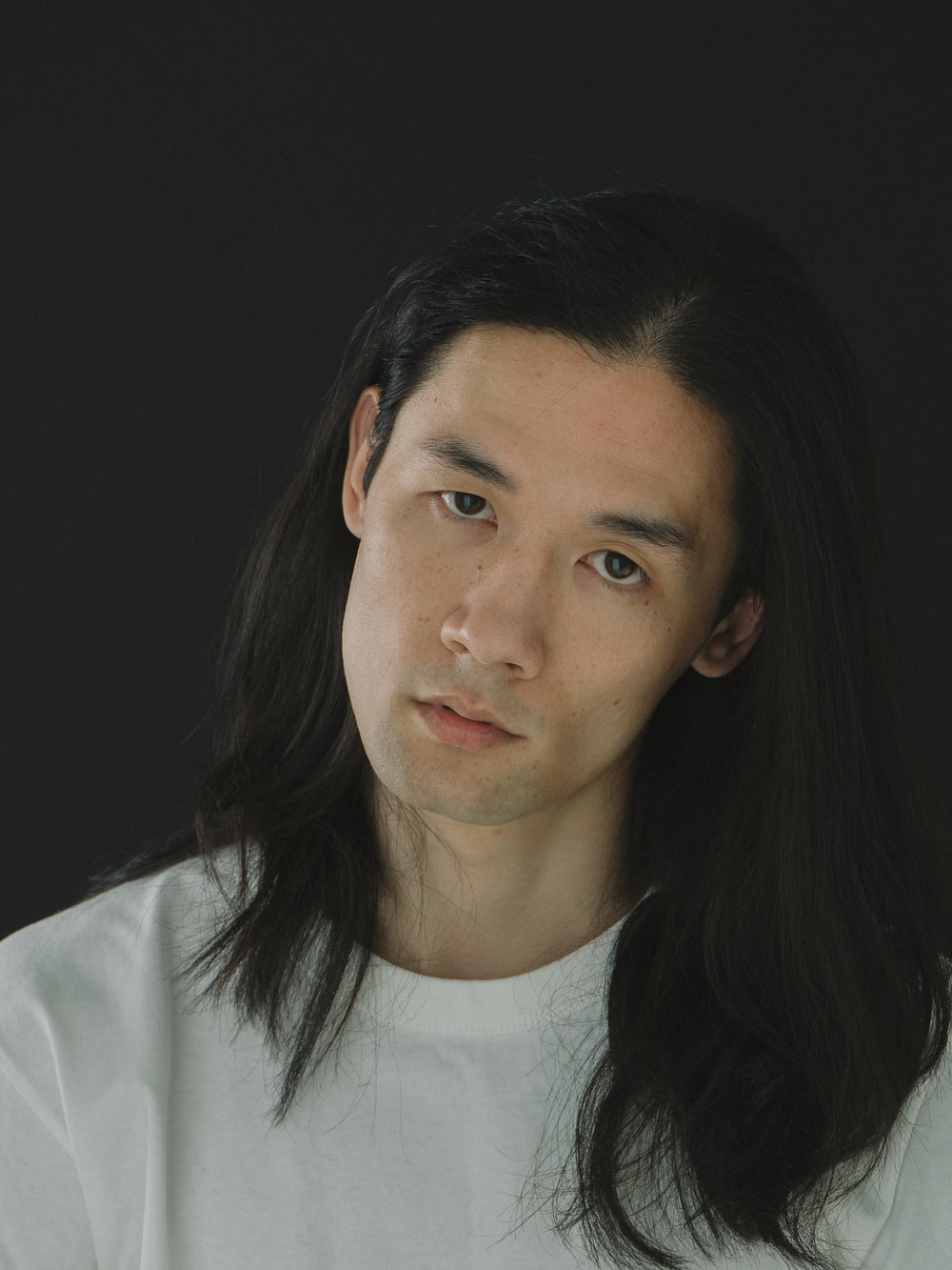 man wearing white crew-neck shirt