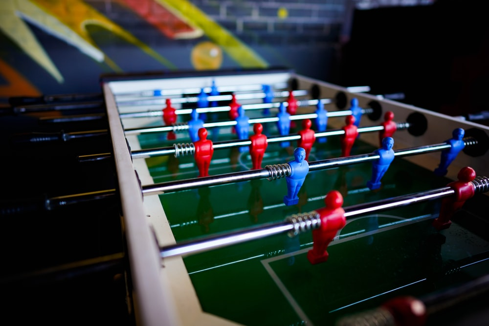 assorted-color Foosball table
