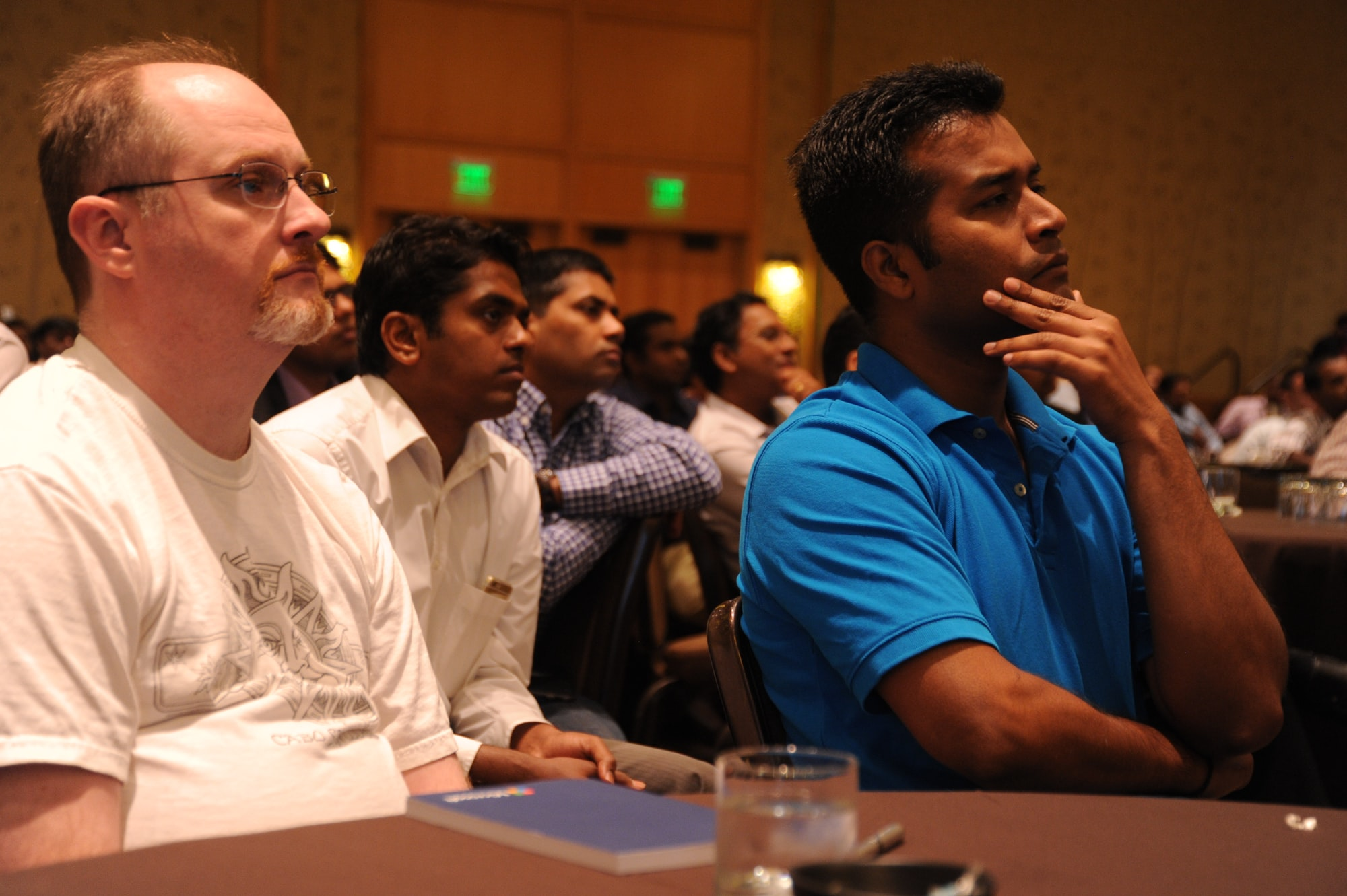 """Developers, database administrators, technologists, many in the US on H1-B Visas to work, mostly men, some US citizens, some Canadians, during a Town Hall company meeting, """"Design Thinking: because it betters us in our disciplines"""", Bellevue, Washington, USA"""