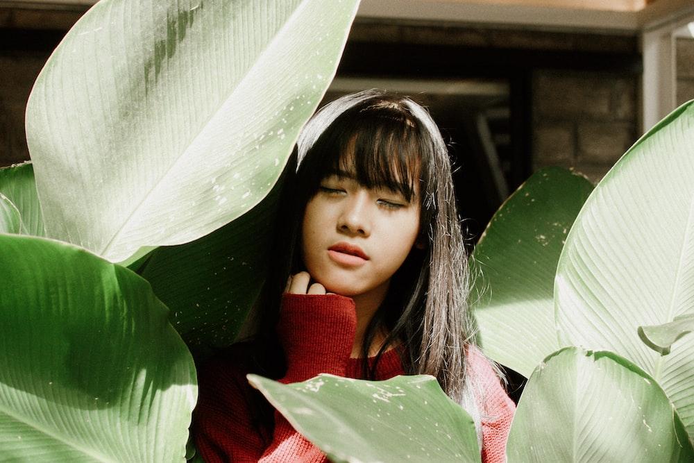 woman among leaves