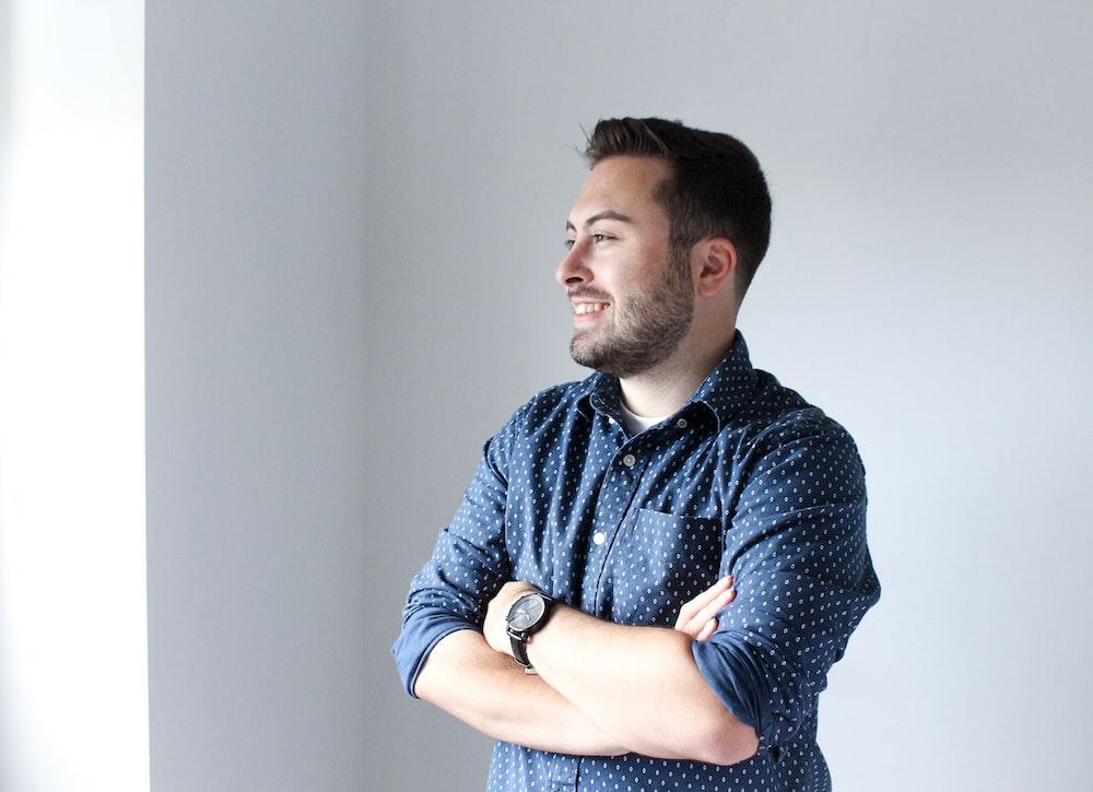 man in navy-blue dress shirt
