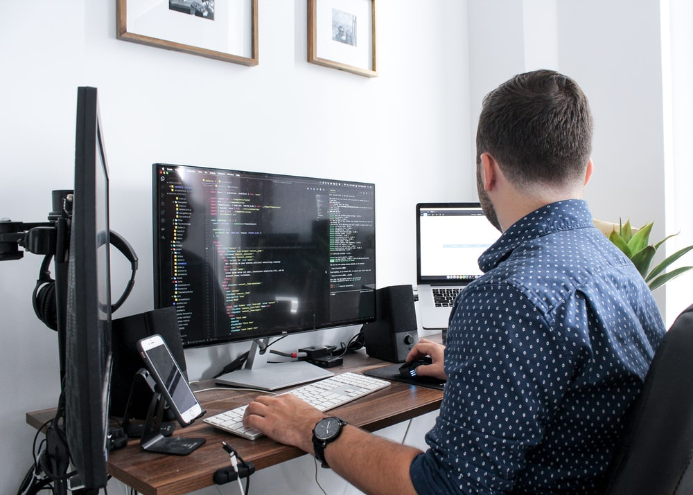 man sits infront of the computer