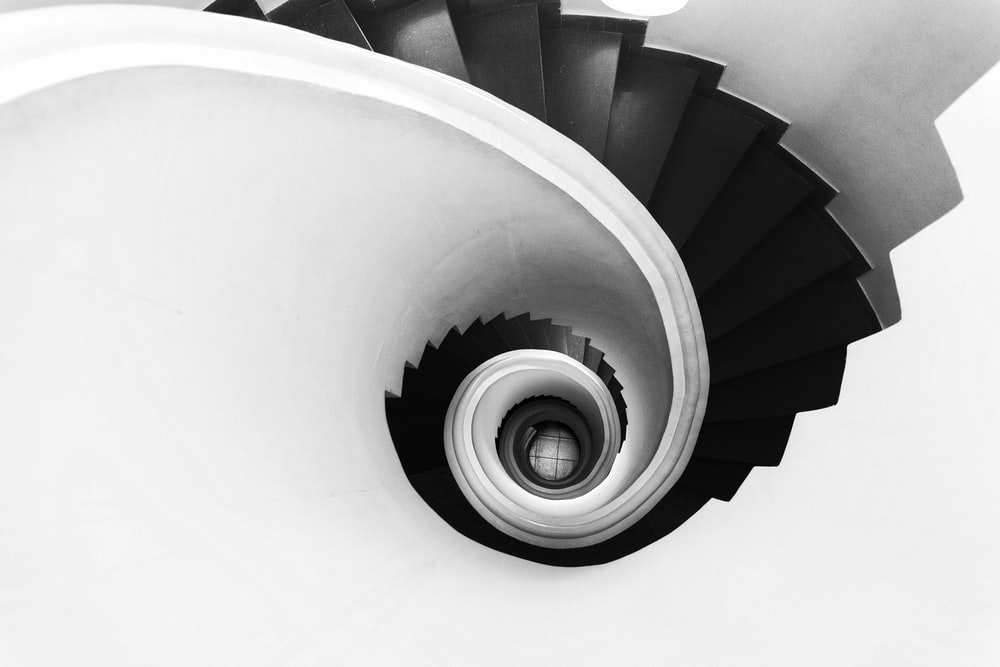 gray and black spiral stairs