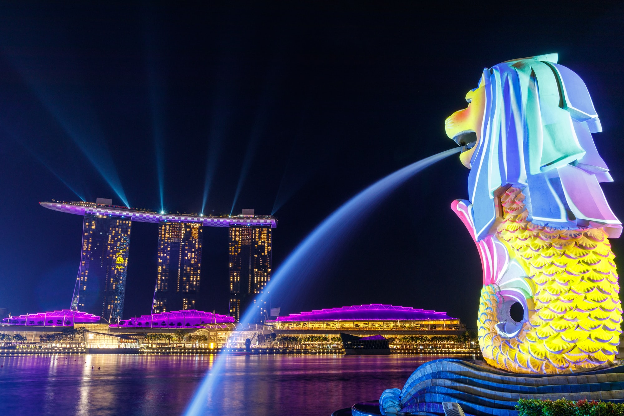 Lights shone on the Merlion as it overlooks Singapore's iconic Marina Bay Sands. During the Formula 1 Grand Prix night race, lights were projected onto the Merlion and the 'boat' of Marina Bay Sands.