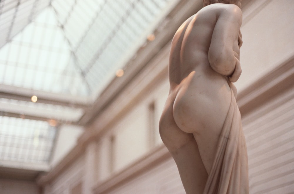 low angle photo of naked human statue