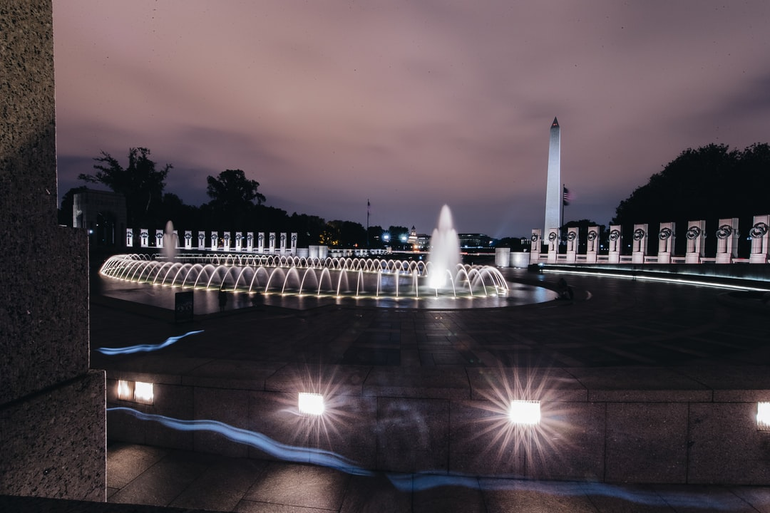Night time long exposure shot of the World War II Memorial and Washington Monument in Washington, DC
