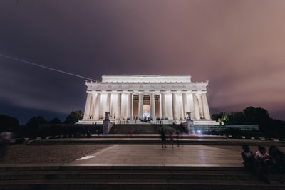 white concrete building at night lincoln memorial teams background