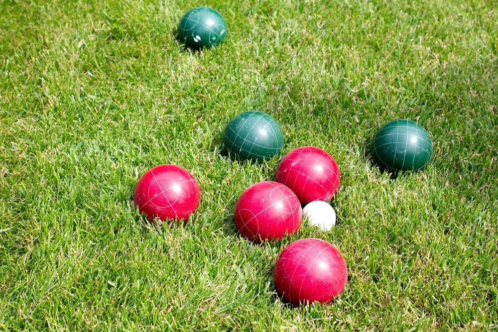 red and green balls in green field