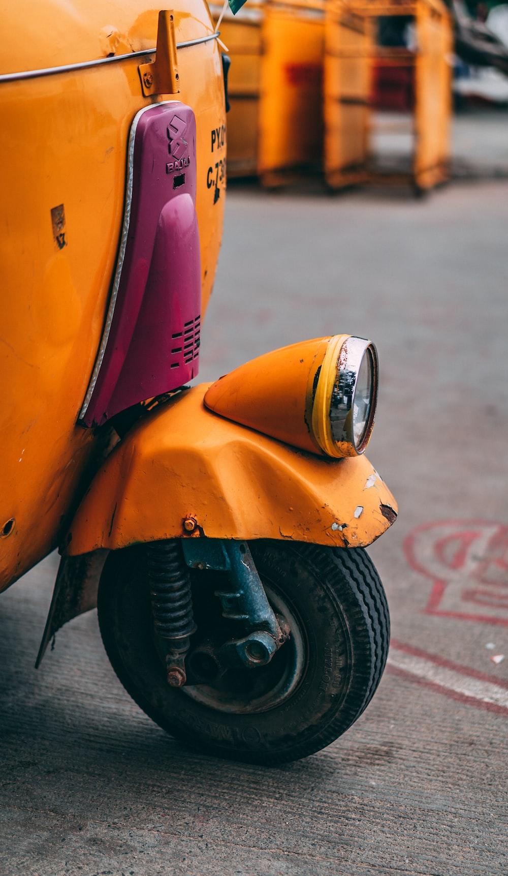orange auto-rickshaw