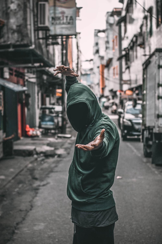 man in green hoodie