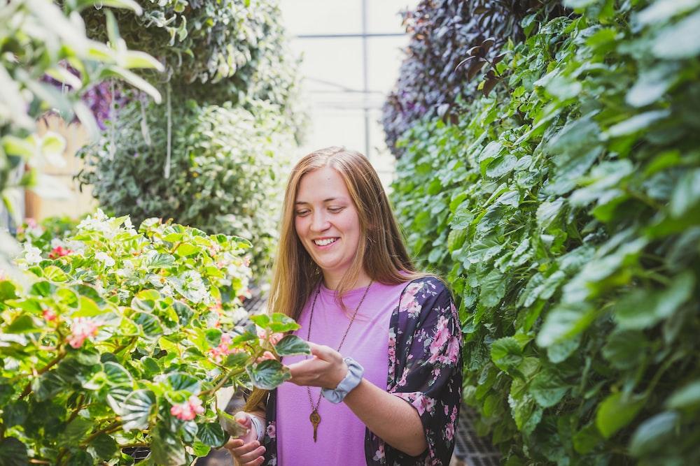 woman between plants