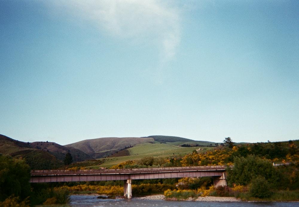 bridge and hill under blue sky