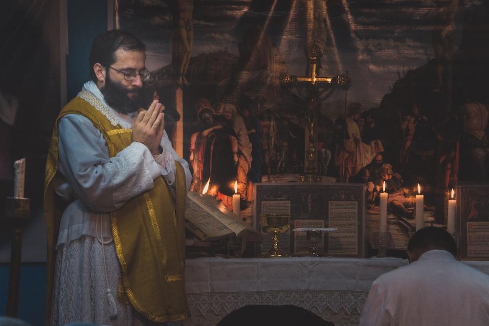 man standing and praying