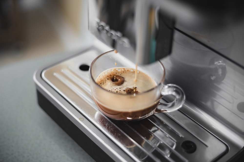 cup of coffee on coffeemaker